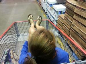 girl riding in shopping cart